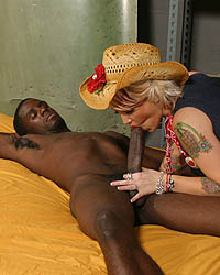 Cowgirl Riding The Black Bull